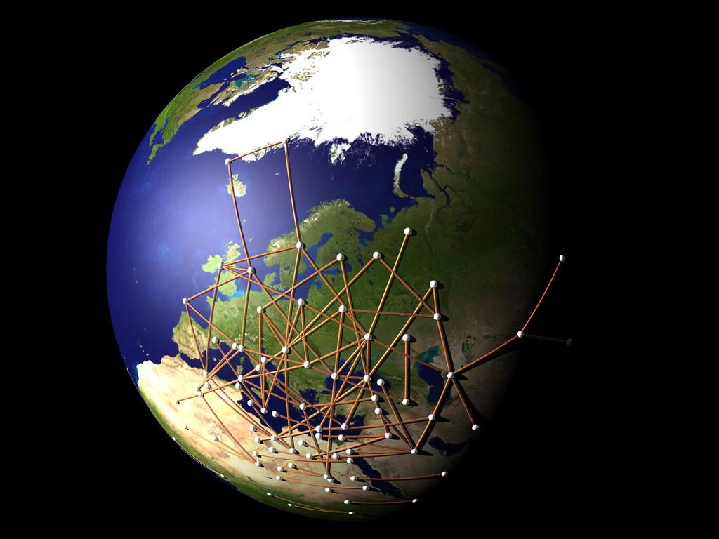 A picture of the earth with lines and dots creating a network