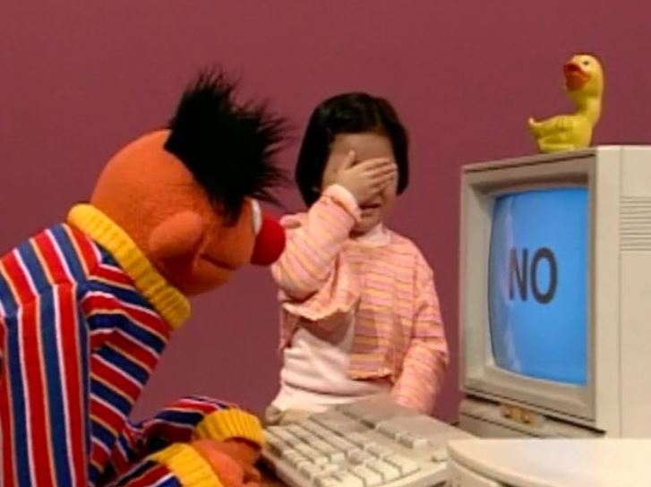 Ernie the Muppet at computer with little girl